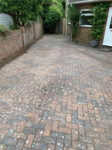 Clean and sweep - driveway before power washing